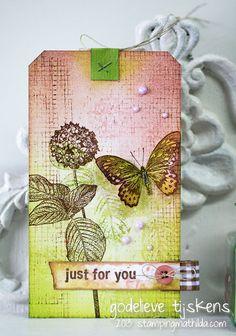 Beautiful tag created by Godelieve Tijskens using Darkroom Door Rubber Stamps.