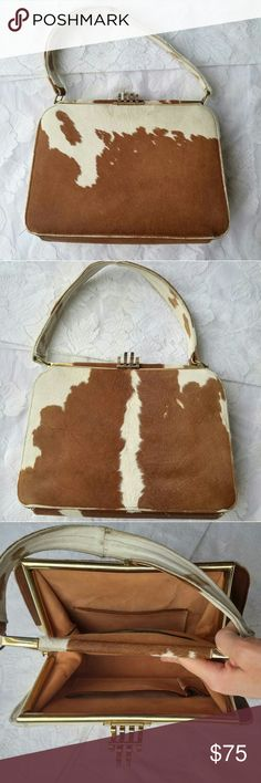 "Vintage Cow Hair Purse Handbag Brown & White This vintage genuine cow hair purse is too good to pass up. It has vintage wear throughout, small bald spots (due to color they look like spots from a distance), no functional flaws.   6.5"" strap drop 7.5"" height 9.5"" long across base panel 3.25"" wide Bags"