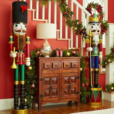 Let a couple of life-size nutcrackers stand guard to give Christmas visitors a royal welcome.