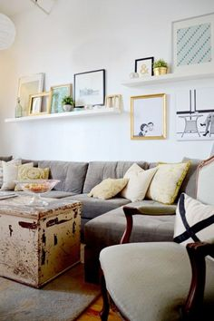 Try a floating ledge shelf scheme for your gallery wall. Explore photos of various ledge gallery walls and decide if it's a gallery wall style that would work in your home.