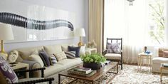 The living room of this Manhattan townhouse bears the hallmarks of a project designed by Timothy Whealon, from the tranquil wall color to the subtle mix of textures and ethnic objects as well as the artful blend of antiques and the new, clean-lined furnishings of his own design. An antique chandelier counter-balances a photograph by Fernando Laszlo. Sofa, in Rogers & Goffigon linen, end tables and rug, all custom. Lamps, Eric Appel. Antique coffee table, Lucca & Co. Curtains in Clarence ...