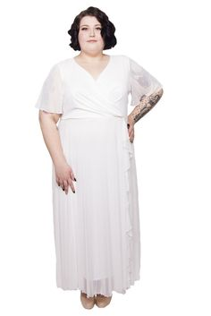 """Beautifully cut bridal maxi dress made in our super soft chiffon mesh. Featuring soft angel sleeves, and a beautifully ruffled front with a thin elasticated band to gently cinch you in at the waist and highlight your silhouette. Perfect for your special day! Easy wear, Easy Care.  Model: size 24 and 5'8""""/173 cm tall"""