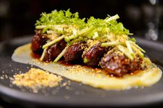 Whiskey glazed pork cheeks with parsnip puree at Tupelo in Park City. (Trent Nelson  |  The Salt Lake Tribune)