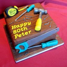 Joiner's Birthday Cake with a hammer, screwdrivers and a saw made from icing.