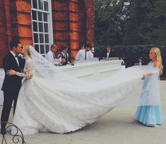 Nicky Hilton gave Kate Middleton a run for her money in a high-necked, long sleeved Valentino ballgown.
