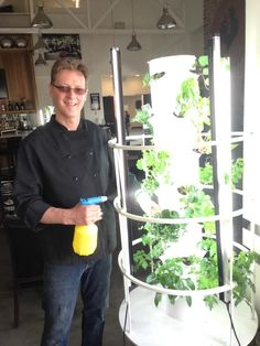 Our extraordinary Chef Harry maintaining the grills Tower Garden so we can keep adding fresh #organic #herbs to our dishes!