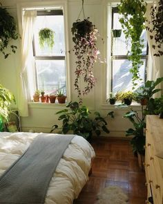 such a pretty bedroom full of greenery
