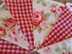 Love the contrast of the bunting...gingham and florals... yum!!