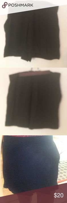 Black skort Removed the tag before I realized they were too large for me. I believe these should be marked size 4. Brand is 12th Street by Cynthia Vincent. I think they are rayon material. Very versatile - pockets! Cynthia Vincent Shorts Skorts
