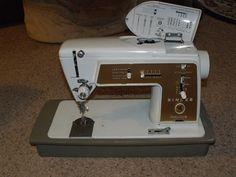 Singer 603E, a Touch & Sew Slant-o-Matic that can do a chain stitch.  And, she was born the same year I was!  I have all the cams and attachments, too!