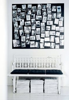 I love this! b & w photos against a black canvas, stacks & stacks of mags underneath a seat