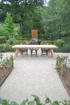 oak table on trestle by In Tempo
