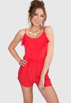 New Wave Playsuit - Coral If you're going to be flirty do it in this adorable playsuit. This romper features a scoop neck with ruffle flounce and adjustable tie v-back.  Elastic waist for the perfect fit. Unlined.