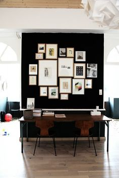 Black wall with frame collection.