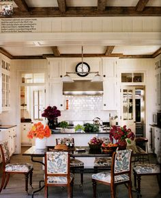 ceiling, low back chairs covered in beautiful fabric, transom windows, cozy space, white cabinets