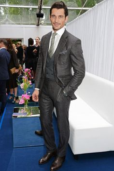 David Gandy in a Tom Ford suit with contrasting waistcoat. Featured as one of the best-dressed men on the red carpet of Glamour's Women of the Year Awards in GQ-UK.  London, June 2014