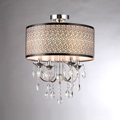 Add visual interest to your space with this stunning flush-mount pendant light from Warehouse of Tiffany. This gorgeous piece features lavish crystals suspended from an intricate chrome-finished drum, creating a delightful spectacle to enjoy.