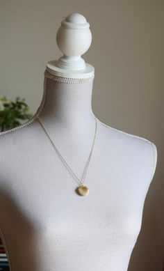 Sea Shell Locket Necklace, Seashell Locket Pendant, Gold Locket, Gold Sea Shell Necklace, Ocean Jewelry, Beach Jewelry, Nautical Wedding DESCRIPTION AND DETAILS: This elegant necklace is made with a gold plated brass chain and gold brass sea shell locket . The sea shell locket pendant