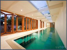 nice bifold doors with the colour of the pool, timber frames, skylights