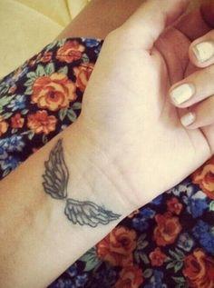 Angel wrist tattoo