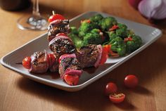 Grilled Tuscan Skewers - Wood-grilled sirloin, red onion and tomato skewers topped with our Chianti wine sauce