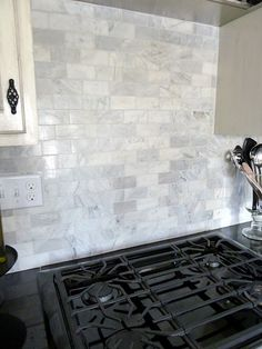 "Venatino polished marble from Lowe's. It's a 2""x4"" marble tile that comes in a 12""x12"" mosaic for $9.98."