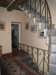 #wrought#iron banisters and railings, hand-hewn #staircase in #medieval #stone#farmhouse #casadeisogni