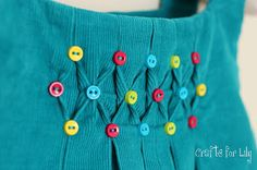 smocked with buttons =) - Definitely have to try this on corduroy someday -- also love how it combines with the pleats