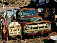 Old Ford and Quaker Oil Sign Old Ford Trucks, Old Pickup Trucks, Farm Trucks, Cool Trucks, 4x4 Trucks, Lifted Trucks, Ford Motor Company, Pompe A Essence, Old Gas Stations