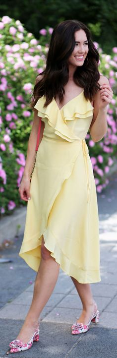Summer fresh look with pink lips, glowing skin, and long wavy hair. How flattering and gorgeous is this yellow dress ($65!!!)? the wrap ties in the perfect place and the ruffles are what small chested ladies need! By fashion blogger Marie's Bazaar
