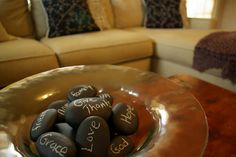 A simple idea: Chalkboard Rocks. Get a can of chalk paint at your hardware store and paint several rocks. The paint will cost you a few dollars but the rocks are so cheep they're lying on the ground! Its a fun and classy way to add personality to a room and remind your self of goals, mottos, or beliefs---great idea for the coffee table