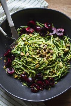 Pistachio Kale Pesto with Zucchini Noodles + Cherries | edibleperspective.com #vegan #glutenfree