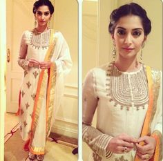 Sonam Kapoor wearing a gorgeous Anamika Khanna creation at a 'Bhaag Milkha Bhaag' promotional event in London. Long dangling earrings and hair tied back in a bun completed the look.