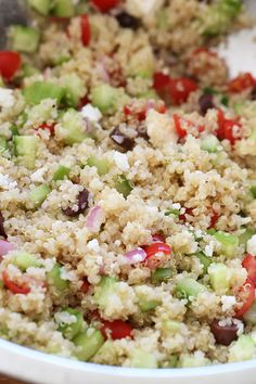 Mediterranean Quinoa Salad (skinnytaste) - delicious and so easy!  I add cucumber, tomatoes and spinach (chopped)