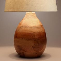Crafted in India of mango wood with a smooth polished finish, our teardrop-shaped table lamp adds a natural element to any room. Inherent variations in the wood grain make each piece truly unique.