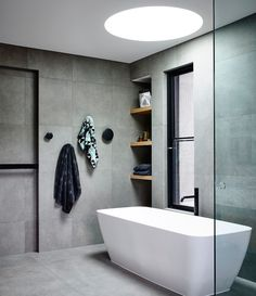 Beautiful free standing bath, black, timber and concrete palette