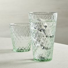 A vintage-inspired, raised trellis pattern decorates this versatile glass, masterfully blown of soft green glass with a slender sham base.