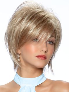 Alexa Wig. A wispy layered hair shag wig with extra length along the sides and bangs. A look with sultry and timeless appeal. From the TressAllure Wig Collection @$131.00 #hair, #wigs, #theheadshopwigs,