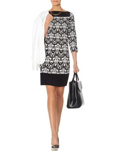 Printed Shift Dress - A tasteful square neck and bold print put unique interest into this form flattering dress!