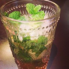 Mint julep. Delish. Super easy - sugar water, bourbon, crushed ice and mint.