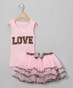 Designed just for cupid's cutest, this festive fashion is ready for a full day of celebration. The tank shows off a festive, sparkly design, while the poufy tutu has a smooth, covered elastic waistband.Includes tank and tutuPolyester / cottonMachine wash; tumble dryImported<...