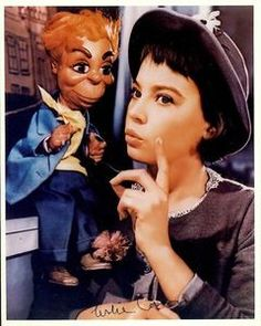 Lili (1953) stars Leslie Caron as a touchingly naïve French girl, whose emotional relationship with a carnival puppeteer is conducted through the medium of four puppets.