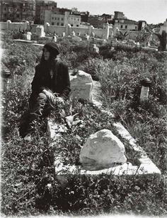 Patti Smith at Genet's grave, Larache Christian Cemetery, by Lenny Kaye.