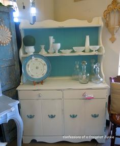 Confessions of a Craigslist Junkie: A Before & After, And a Peek at Mr. P's.  This Provence blue with the white really turns this former ugly hutch into a charming French-country kitchen addition. Just love these colors!