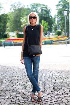 Classic summer chic. Black sleeveless crewneck, skinny jeans, black slides (Hermes) and black crossbody (Celine)