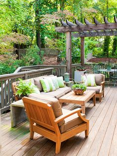 Arbor over half of a deck adds dimension, plus looks fancy w/lights