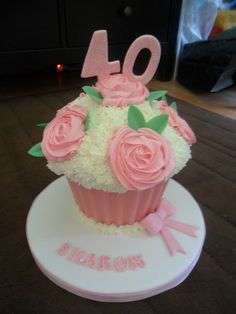 """giant pink cupcake 40th birthday by """"Cupcakes by lizzie"""".lizzies_cakes lizzies cupcake, via Flickr"""