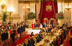 The guests and top table stand after the guests of honour, along with the Royals enter the...