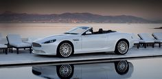 Astin Martin DB9 Volante- i wouldnt even drive it if i had the residence and the car this was shot at. pure beauty