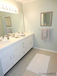 Update an old bathroom with only paint & thrift store finds! Tons of easy tricks to update an outdated bathroom on a small budget!